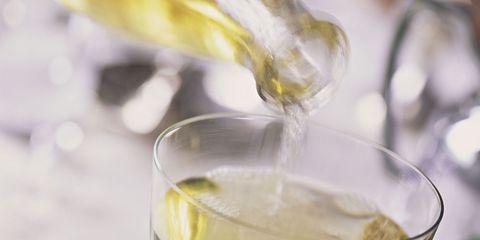 Fluid, Glass, Yellow, Drinkware, Drink, Alcoholic beverage, Tableware, Cocktail, Liquid, Distilled beverage,