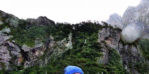Sleeve, Human body, Jacket, Coastal and oceanic landforms, Rock, Happy, Tourism, Mountain, Bedrock, Travel,