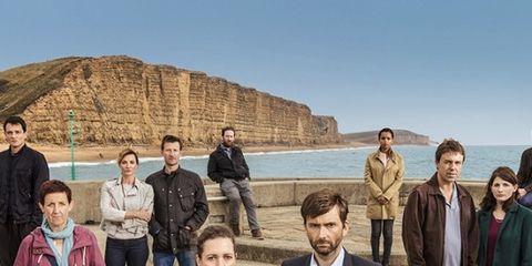Trousers, Coat, Jacket, Coastal and oceanic landforms, Shirt, Standing, Jeans, Outerwear, Tourism, Denim,