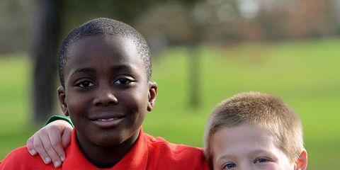 People, Smile, Child, Grass, Team, Team sport, Player, T-shirt,