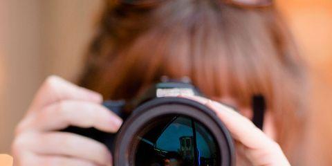 Photographer, Finger, Lens, Cameras & optics, Digital camera, Camera accessory, Colorfulness, Photograph, Camera lens, Mirrorless interchangeable-lens camera,