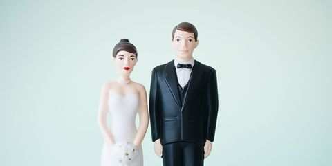 Standing, Formal wear, Dress, Suit, Saving, Gown, Bridal clothing, Wedding dress, Toy, Money,