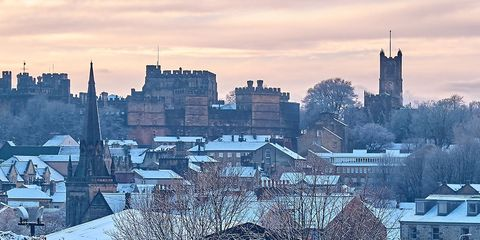 Sky, Winter, Snow, Cloud, Freezing, Mountain, Landmark, Urban area, Roof, City,