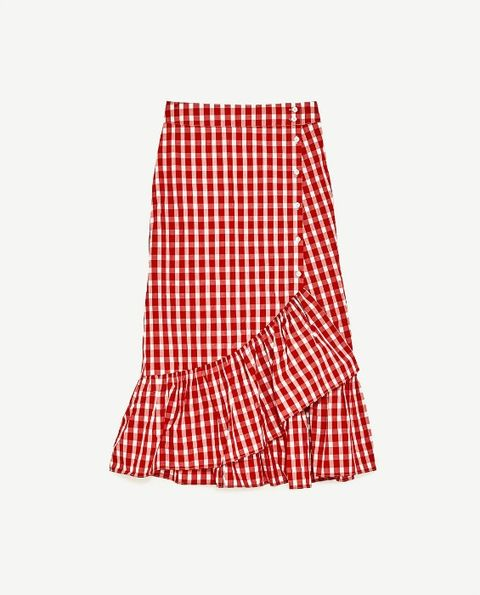 a06e35fa80 The midi skirt, which features this year's biggest trend - gingham - sold  out almost immediately when it first appeared in stores.