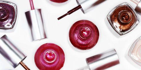 Pink, Material property, Nail polish, Nail care, Button, Lip gloss, Cosmetics, Circle,