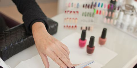 Finger, Hand, Nail, Plastic bottle, Wrist, Thumb, Stationery, Cosmetics, Job, Desk,