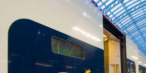 Transport, Yellow, Railway, Rolling stock, Train station, Electricity, Glass, Public transport, Light, Train,