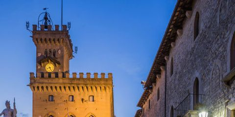 Landmark, Town, Sky, Building, Architecture, City, Night, Yellow, Medieval architecture, Town square,