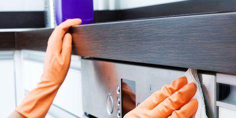 Orange, Hand, Furniture, Finger, Desk, Major appliance, Drawer, Home appliance, Table, Gesture,