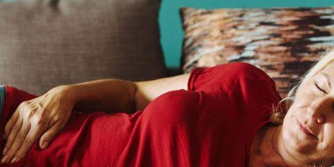 Red, Arm, Leg, Nap, Sleep, Shoulder, Hand, Joint, Human body, Furniture,