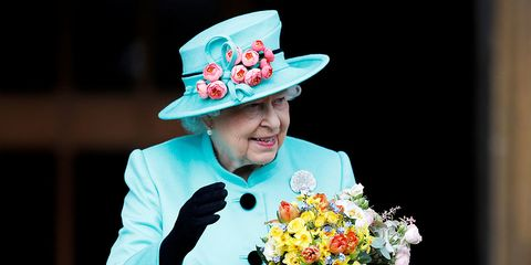 Turquoise, Formal wear, Performance, Flower, Bouquet, Plant, Smile, Tradition, Fashion accessory, Artificial flower,
