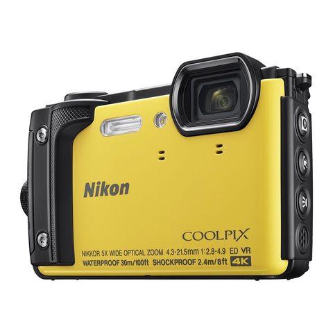 Camera, Digital camera, Cameras & optics, Point-and-shoot camera, Camera accessory, Yellow, Reflex camera, Material property, Font, Technology,