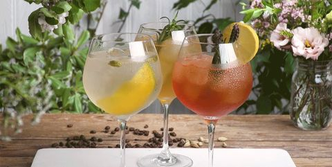 Drink, Yellow, Glass, Cocktail, Wine glass, Table, Distilled beverage, Juice, Non-alcoholic beverage, Brunch,