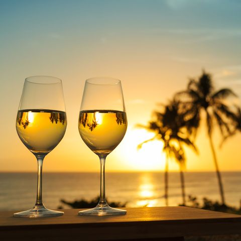 Stemware, Wine glass, Champagne stemware, Glass, Drinkware, Drink, Water, Sky, Alcoholic beverage, Sunset,