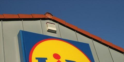 Sign, Signage, Yellow, Traffic sign, Font, Advertising, Logo,