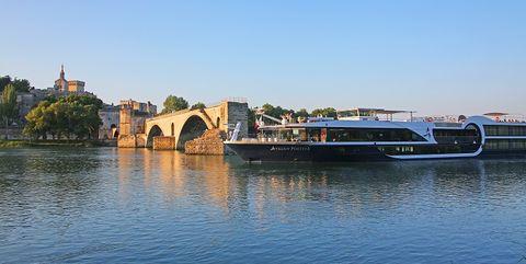 Water transportation, River, Bridge, Waterway, Water, Transport, Sky, Architecture, Vehicle, Arch bridge,