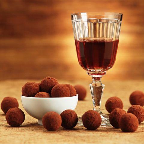 Food, Liqueur, Chocolate truffle, Still life photography, Drink, Distilled beverage, Nut, Ingredient, Glass, Drinkware,