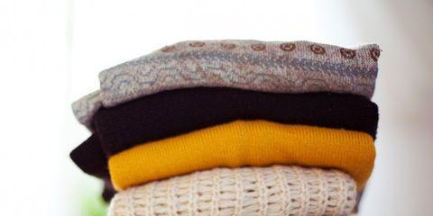 Wool, Yellow, Towel, Purple, Brown, Textile, Linens, Headgear, Font, Woolen,