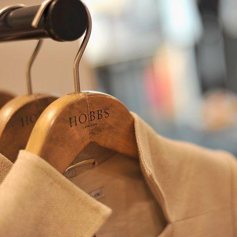 Clothes hanger, Textile, Beige, Metal, Shoe,