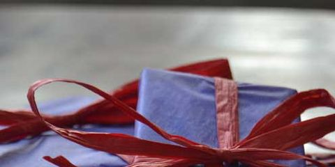 Red, Gift wrapping, Ribbon, Present, Carmine, Party favor, Paper product, Material property, Confectionery, Knot,