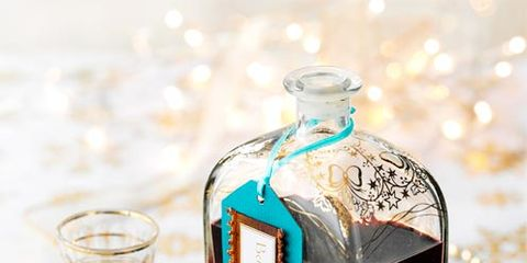 fluid, liquid, bottle, drinkware, serveware, glass bottle, teal, glass, distilled beverage, perfume,