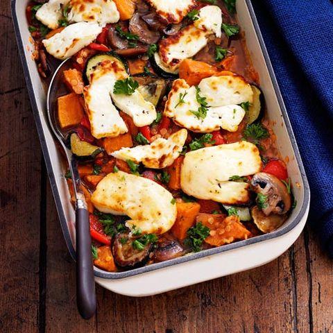 best traybake recipes roasted vegetable, lentil and halloumi bake