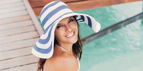 Clothing, Finger, Skin, Hat, Human leg, Summer, Sitting, Sun hat, Thigh, Beauty,