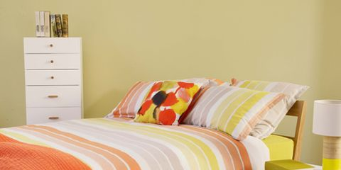 Bed, Room, Green, Yellow, Bedding, Interior design, Bedroom, Textile, Bed sheet, Furniture,