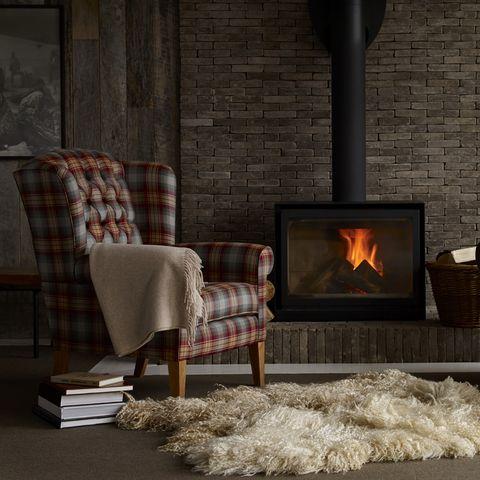 Hearth, Heat, Wood-burning stove, Fireplace, Room, Furniture, Floor, Living room, Stove, Flooring,