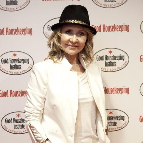 Hat, Sleeve, Collar, Coat, Outerwear, Style, Formal wear, Blazer, Headgear, Logo,