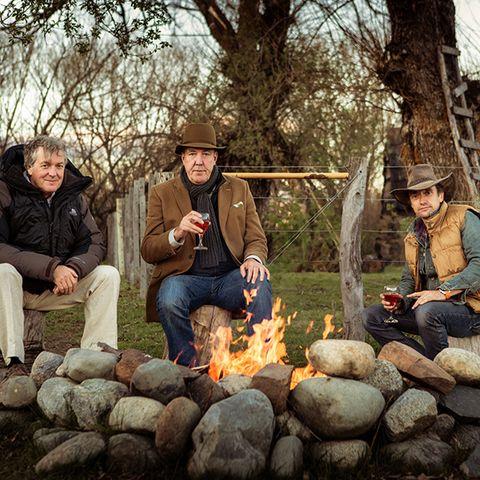 Leg, Sitting, Hat, People in nature, Fire, Sun hat, Bonfire, Lap, Campfire, Fedora,