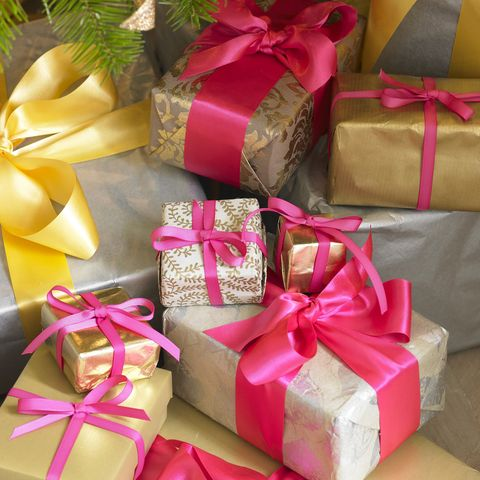 Red, Ribbon, Gift wrapping, Present, Party favor, Paper product, Gold, Material property, Packing materials, Packaging and labeling,