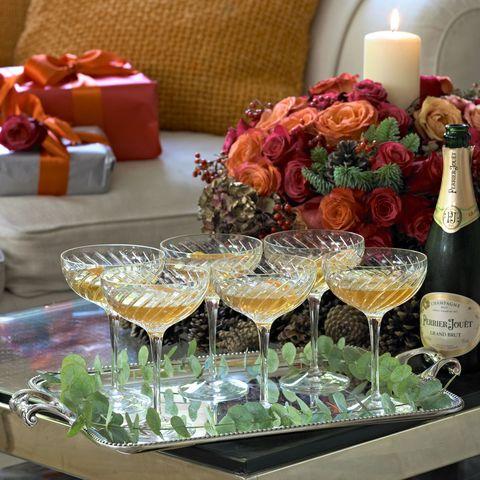 Glass, Barware, Glass bottle, Candle holder, Interior design, Bottle, Stemware, Candle, Wine bottle, Drink,