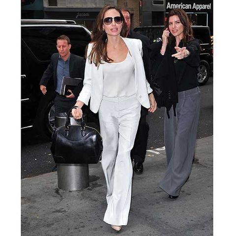 Clothing, Eyewear, Trousers, Coat, Outerwear, Sunglasses, Style, Bag, Fashion accessory, Street fashion,
