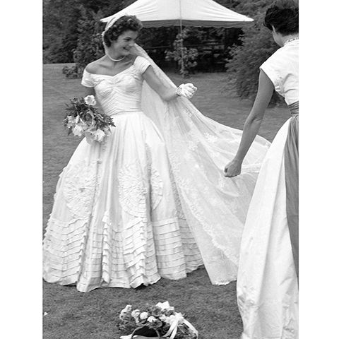 Clothing, Shoulder, Bridal clothing, Dress, Petal, Textile, Photograph, White, Gown, Wedding dress,