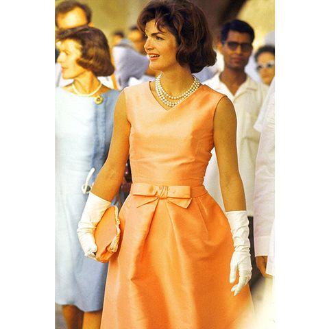Sleeve, Dress, Jewellery, Formal wear, One-piece garment, Amber, Orange, Fashion, Necklace, Day dress,