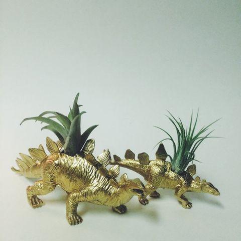 Jaw, Dinosaur, Toy, Terrestrial plant, Figurine, Sculpture, Claw, Tail, Animal figure,