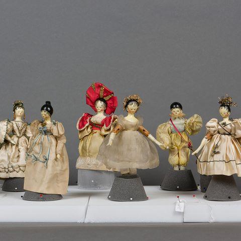 Toy, Headgear, Fashion, Costume design, Victorian fashion, Costume, Headpiece, Vintage clothing, Sculpture, hoopskirt,