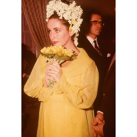 Petal, Yellow, Bouquet, Flower, Coat, Cut flowers, Floristry, Flower Arranging, Floral design, Flowering plant,
