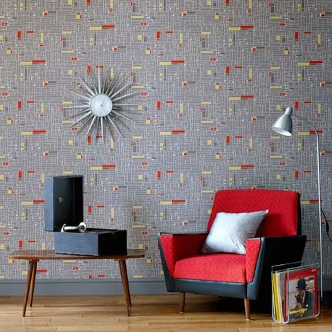 Wall, Room, Furniture, Floor, Interior design, Flooring, Grey, Pillow, Display device, Couch,