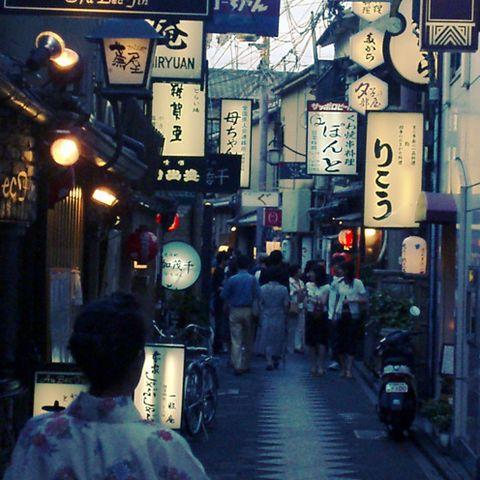 Lighting, Town, Street, Lantern, Human settlement, Snapshot, Pedestrian, Electricity, Market, Electrical supply,