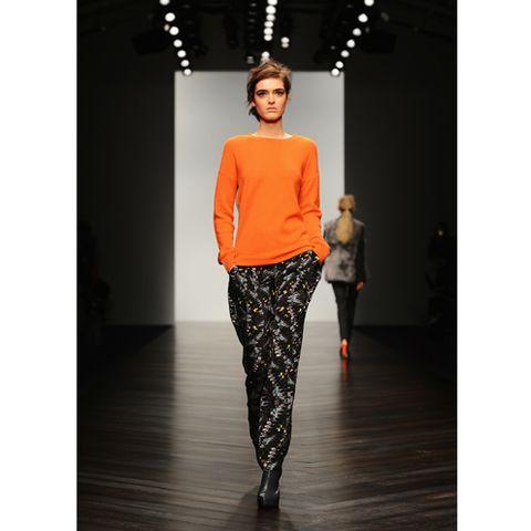 Sleeve, Joint, Standing, Style, Fashion show, Street fashion, Waist, Orange, Fashion, Neck,