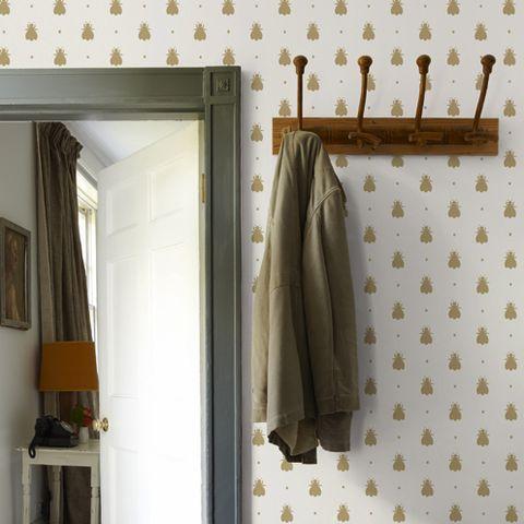 Room, Textile, Coat, Interior design, Grey, Linens, Beige, Khaki, Clothes hanger,