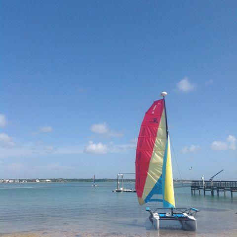 Body of water, Sky, Coastal and oceanic landforms, Watercraft, Boat, Waterway, Sail, Beach, Ocean, Sea,