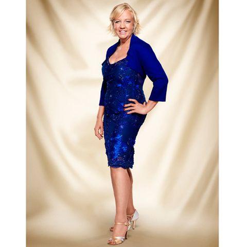 Clothing, Shoulder, Dress, Human leg, Joint, One-piece garment, Style, Electric blue, Fashion, Fashion model,
