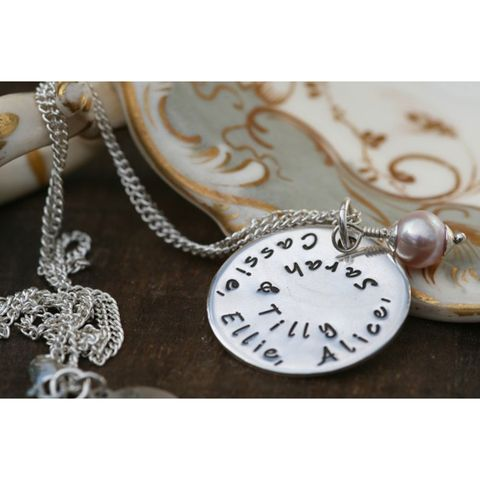 Chain, Metal, Locket, Beige, Still life photography, Natural material, Material property, Circle, Silver, Pocket watch,