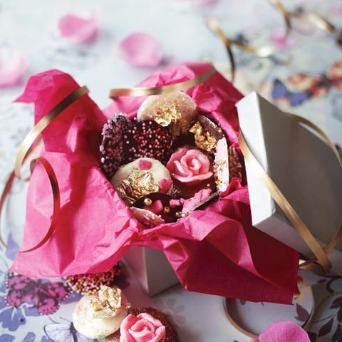 Petal, Red, Pink, Party supply, Sweetness, Dessert, Cut flowers, Artificial flower, Ribbon, Toy,