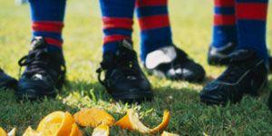 Shoe, Sock, Orange, Carmine, Athletic shoe, Outdoor shoe, Walking shoe, Cleat, Vegetable,