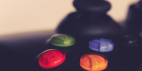 Red, Light, Game controller, Joystick, Sky, Technology, Electronic device, Material property, Colorfulness, Input device,