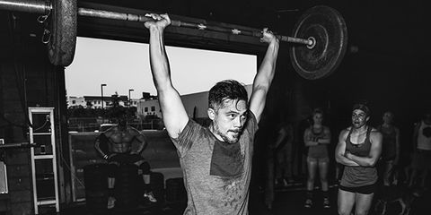 Arm, Weightlifter, Human leg, Chin, Shoulder, Standing, Elbow, Chest, Physical fitness, Monochrome,